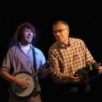 Dan Walsh playing Banjo and Alistair Anderson playing concertina