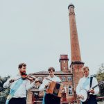 Ross Grant, Will Pound and Benji Kirkpatrick playing fiddle, melodeon and banjo
